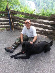 Picture of Reverend Lauren Deer with her dog